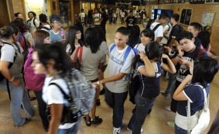 Students pass through the hallway at Lincoln High in Denver. Photo by Kathryn Scott Osler / Getty Images