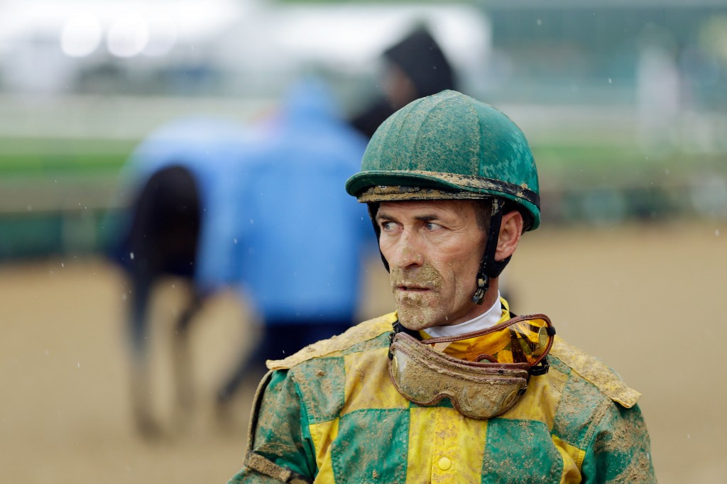 Jockey Gary Stevens looks on after a race prior to the 139th running of the Kentucky Derby at Churchill Downs on May 4, 2013. Stevens, a jockey since 1979, originally retired in 2005 and came out of retirement in 2013. Photo by Rob Carr/Getty Images