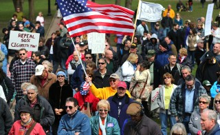 Hundreds showed up on the Boston Common for an anti-tax tea party rally in April 2013. Photo by John Tlumacki/The Boston Globe via Getty Images