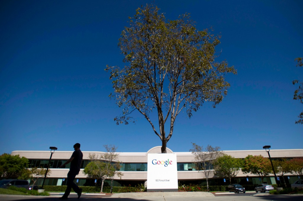 A pedestrian walks pas Google's headquarters in Mountain View, California in 2013. Photo by David Paul Morris/Bloomberg