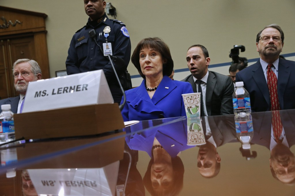 Former IRS official Lois Lerner (C) exercises her Fifth Amendment right not to speak about the IRS targeting investigation before the House Oversight and Government Reform Committee during a hearing on March 5. Photo by Chip Somodevilla/Getty Images