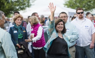 Candidate for U.S. Senate Karen Handel waves to the crowd as she is introduced at the annual Law Enforcement Cookout at Wayne Dasher's pond house in Glennville, Ga., on April 17. Photo By Bill Clark/CQ Roll Call