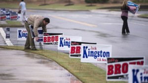 Campaign workers plant signs before the debate of Republican candidates vying for Georgia's open U.S. Senate seat at the Columbia County Exhibition Center in Grovetown, Ga., April 19. Photo By Bill Clark/CQ Roll Call