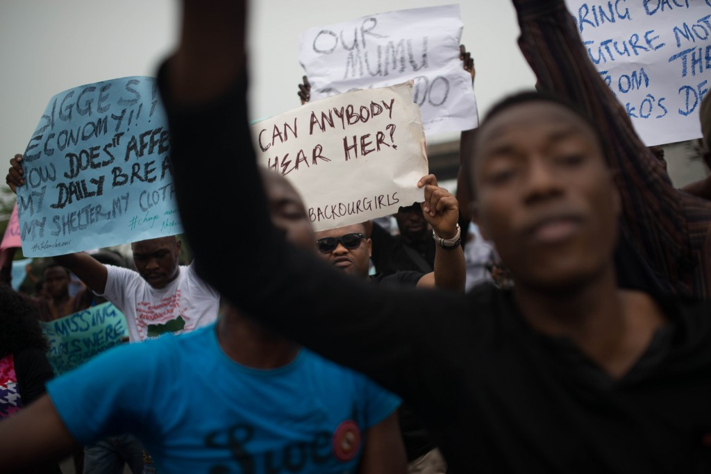 Nigerians march on during a May 1st demonstration to demand government to rescue schoolgirls abducted by suspected Boko Haram militants two weeks ago, in Lagos, Nigeria. Photo by Mohammed Elshamy/Getty Images