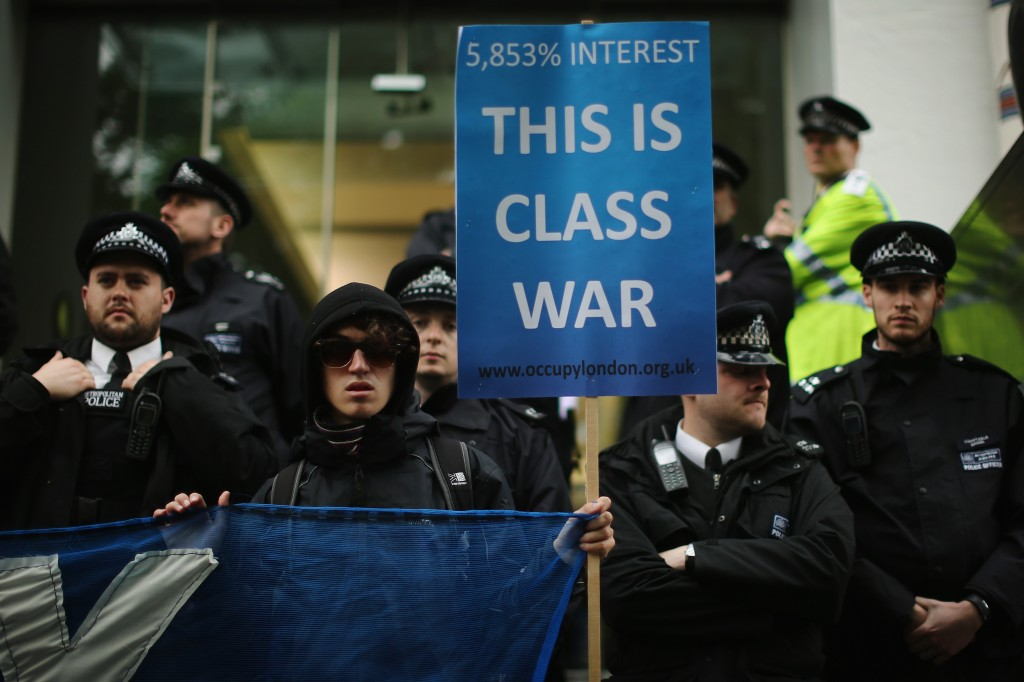 'Occupy' protesters demonstrate against British payday loan company 'Wonga' after the annual May Day march in Trafalgar Square on May 1, 2013 in London, England. Photo by Dan Kitwood/Getty Images