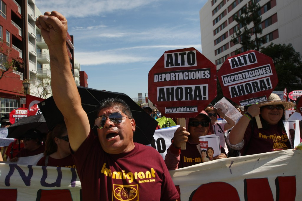 People rally in one a several May Day immigration-themed events in Los Angeles, California. Demonstrators are calling for immigration reform and an end to deportations of undocumented residents. Photo by David McNew/Getty Images