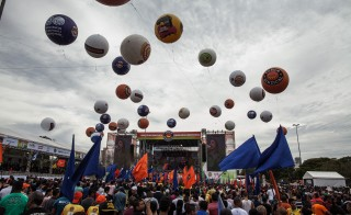 "Associated workers of the unions confederations participate in traditional celebrations of May Day in the ""Campo de Marte"", downtown São Paulo on Thursday, May 1, 2014. Photo by Victor Moriyama/Getty Images"