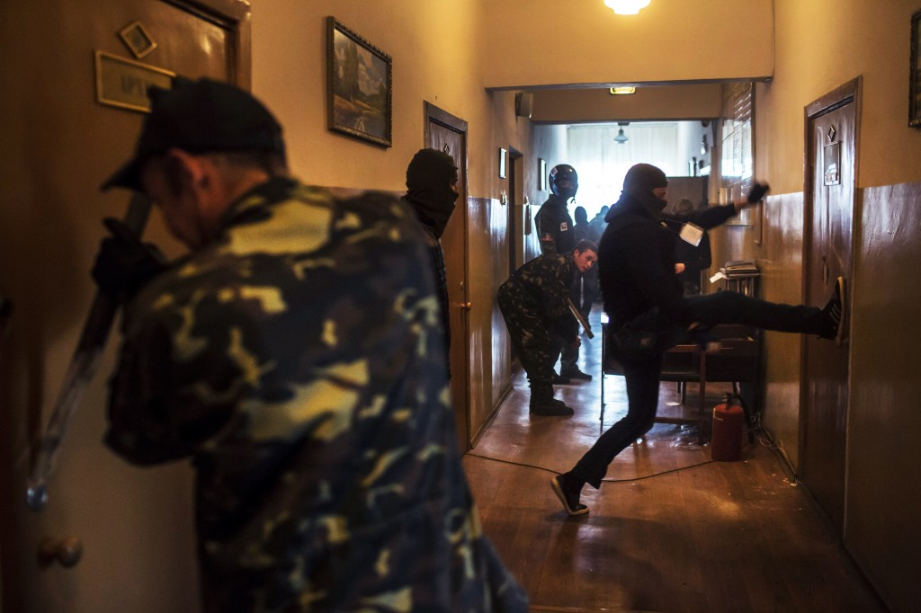 Pro-Russian protesters occupy and ransack the military prosecutor's office on May 4, 2014 in Donetsk, Ukraine. Photo by Brendan Hoffman for The Washington Post