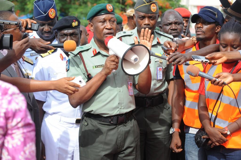 Nigerian Defense spokesman Maj. Gen. Chris Olukolade (center) speaks to civil society groups protesting the abduction of more than 200 schoolgirls in April during a rally in Abuja on May 6, 2014. Photo by Pius Utomi Ekpei/AFP/Getty Images