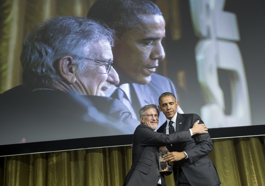 Director Steven Spielberg presents President Barack Obama with an award during the Shoah Foundation Ambassadors for Humanity 20th anniversary dinner May 7, 2014 in Los Angeles, California. Photo By Brendan Smialowski/AFP/Getty Images