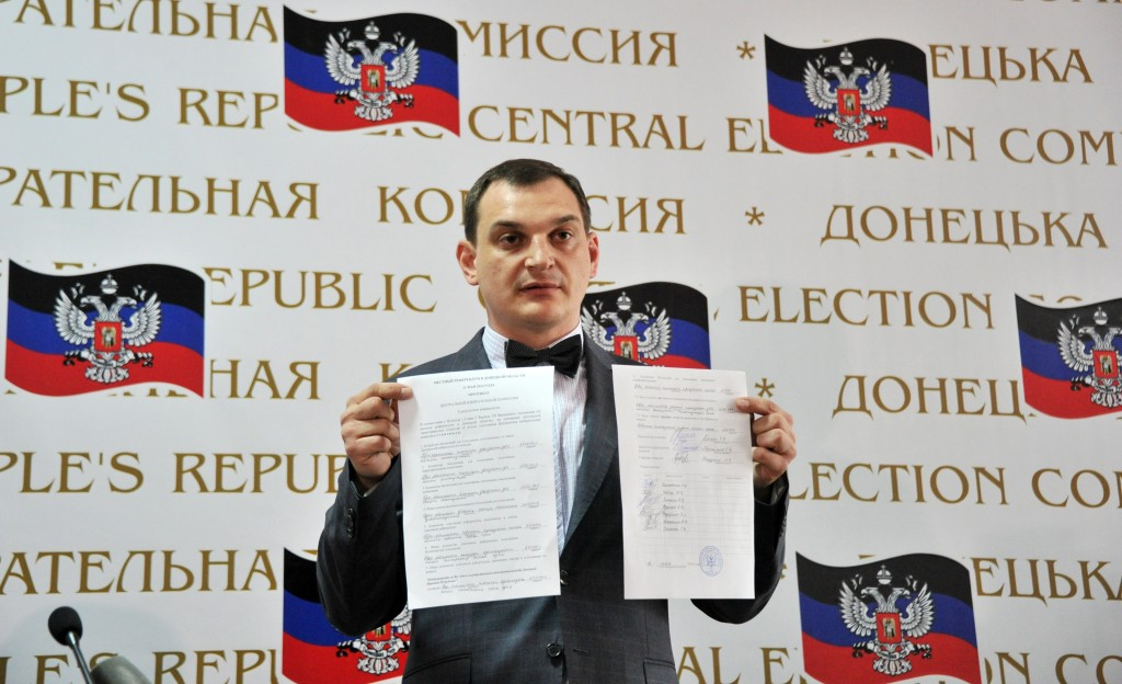 Roman Lyagin (R), chairman of the Central Election Commission of the so-called People's Republic of Donetsk displays protocols with the results of the referendums on the indepence held in two regions of the eastern Ukraine the day before during a press-conference in Donetsk on May 12, 2014. Genya Savilov/AFP/Getty Images