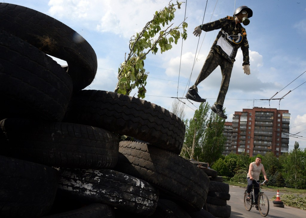 An effigy depicting a representative of the Kiev authorities is hung over a barricade in the eastern Ukranian city of Slavyansk on May 13, 2014. Amid new reports of violence in eastern Ukraine, Europe stepped up diplomatic efforts to resolve the crisis in Ukraine Tuesday, with the German foreign minister in Kiev pushing authorities and pro-Moscow rebels to come together at the negotiating table. Photo by Vasily Maximov/AFP/Getty Images