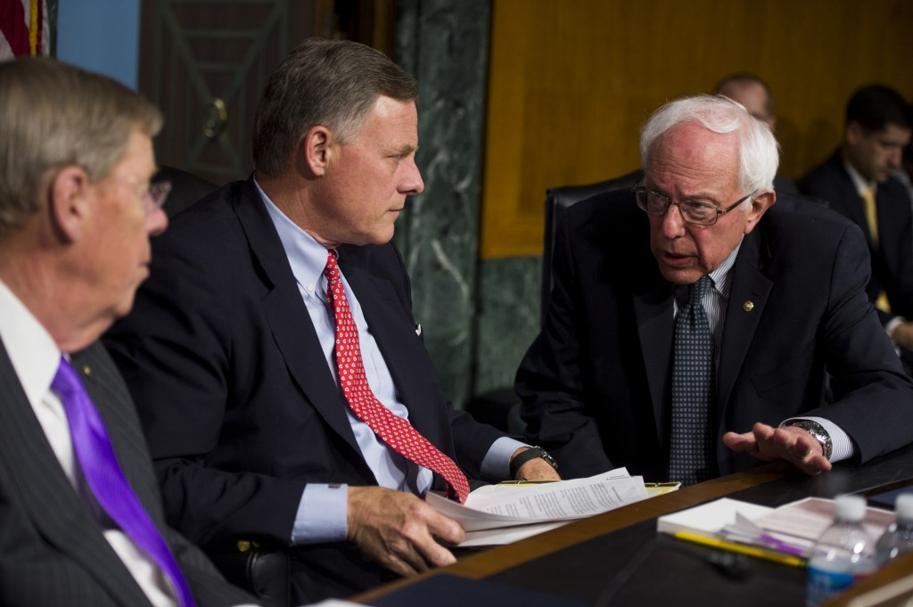 Chairman Bernie Sanders, I-Vt., right, speaks with Sen. Richard Burr, R-N.C., and Sen. Johnny Isakson, R-Ga., before the start of the Senate Veterans' Affairs Committee hearing on 'The State of VA Health Care' on Thursday, May 15. Photo By Bill Clark/CQ Roll Call/