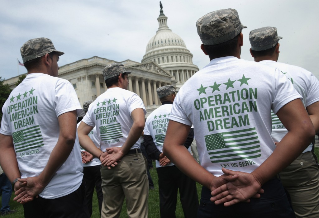 A group of military 'DREAMers' --  undocumented youth who aspire to serve the United States in uniform but are prohibited from doing due to their immigration status --  rally in front of the U.S. Captiol on May 20, 2014 in Washington, DC. The young people were showing their support for the Enlist Act, co-sponsored by Rep. Jeff Denham, R-VA, and Rep. Tammy Duckworth, D-IL, which would amendment to the National Defense Authorization Act to allow some undocumented immigrants to join the military. Photo by Chip Somodevilla/Getty Images