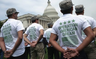 A group of undocumented youth who aspire to serve the United States in uniform rally in front of the U.S. Capitol on May 20, 2014 in Washington, DC. Photo by Chip Somodevilla/Getty Images