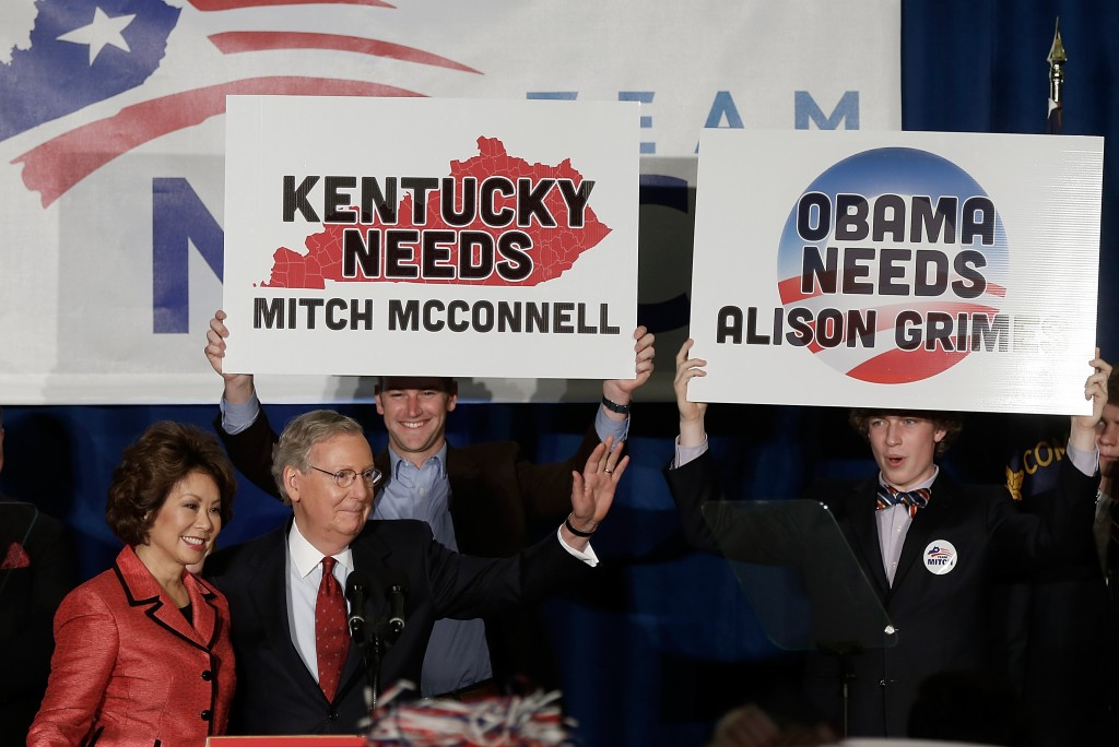 Senate Minority Leader Mitch McConnell and his wife Elaine Chao arrive for a victory celebration following Tuesday's primary results in Louisville, Kentucky. McConnell defeated tea party challenger Matt Bevin and will likely face a close race in the fall against Democratic Kentucky Secretary of State Alison Grimes. Photo by Win McNamee/Getty Images