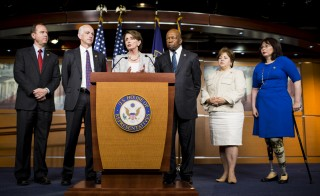 House Minority Leader Nancy Pelosi, D-Calif., center, holds a news conference to announce the Democrats' appointees to the select committee investigating Benghazi on Wednesday, May 21, 2014. The appontees from left are Reps. Adam Schiff, Adam Smith, Elijah Cummings, Linda Sanchez and Tammy Duckworth. Photo By Bill Clark/CQ Roll Call