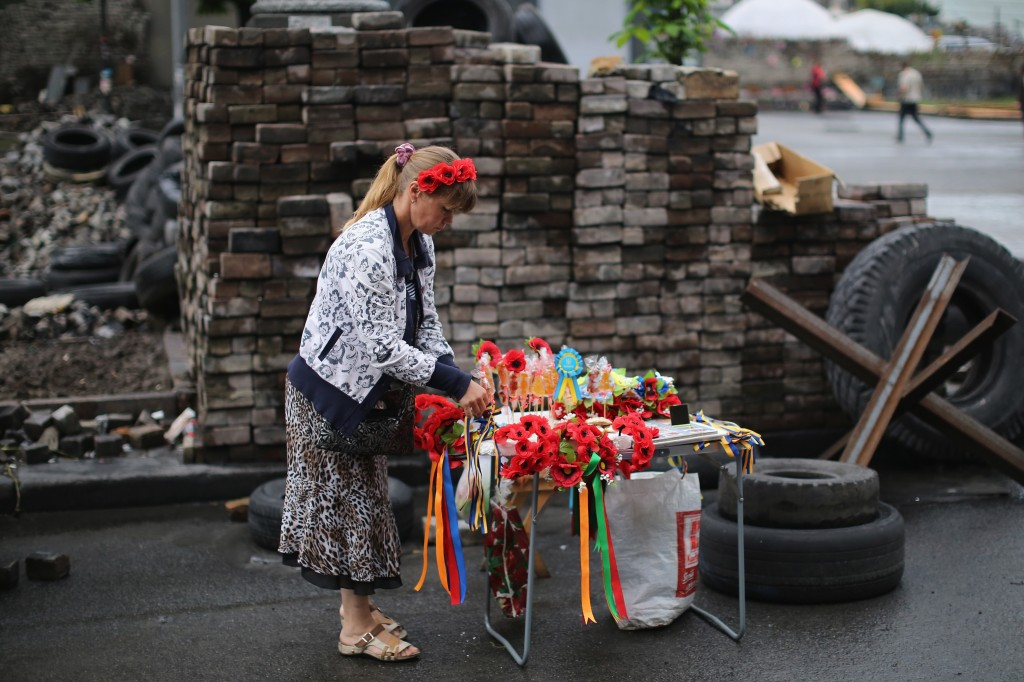 Parts of Maidan Square, site of the original protests in Kiev, Ukraine, have become places for mementoes, souvenir sales and encampments. Photo by Dan Kitwood/Getty Images