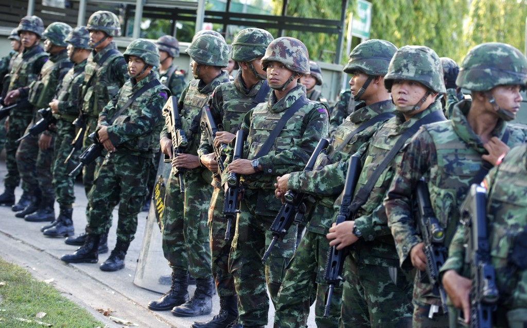 Thai soldiers stand guard after army chief General Prayut Chan-O-Cha met with anti-government and pro-government leaders at the Army Club in Bangkok Thursday. Photo by Pornchai Kittiwongsakul/AFP/Getty Images