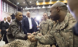 President Obama greets U.S. troops during a surprise visit to Bagram Air Field in Afghanistan May 25. Photo by SAUL LOEB/AFP/Getty Images