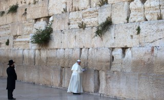 Pope Francis prays at the Western Wall, Judaism's holiest site,  in Jerusalem's Old City on May 26, 2014. Photo by Menahem Kahana/AFP/Getty Images