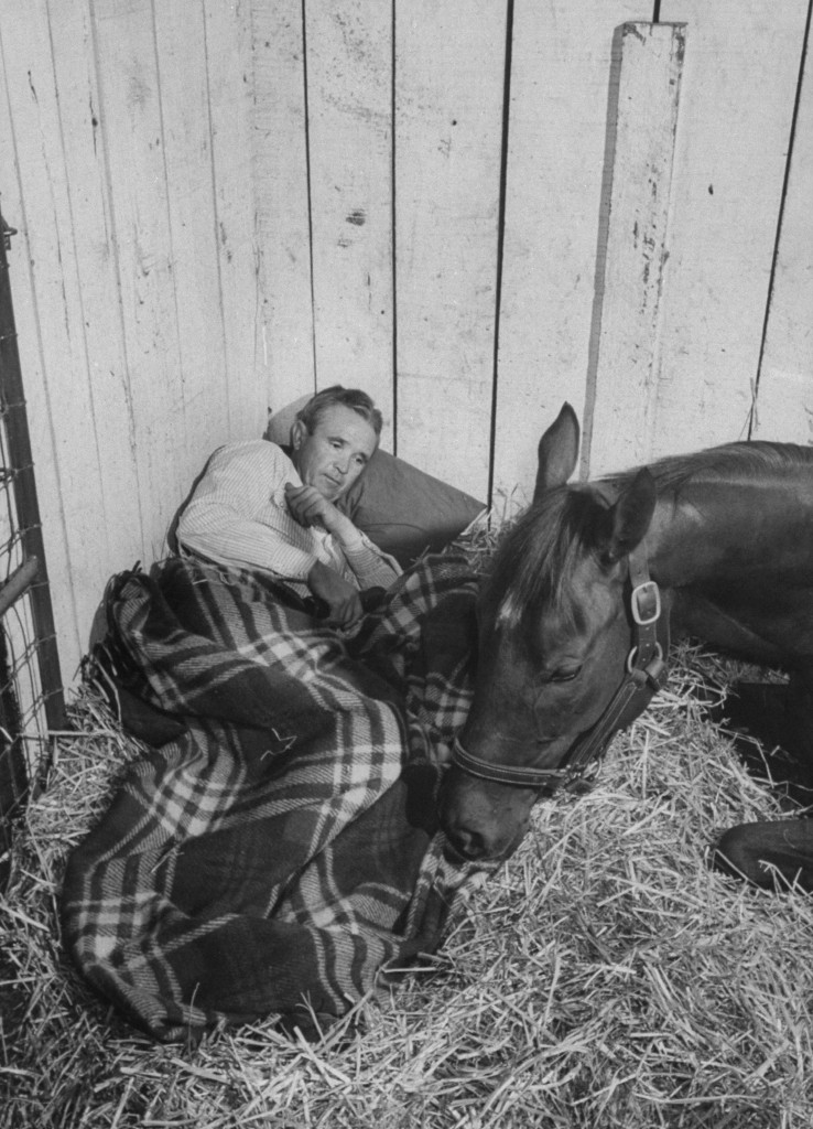 Trainer Meshach Tenny bedding down with his horse Swaps during the days prior to the 1955 Kentucky Derby. Photo by John Dominis//Time Life Pictures/Getty Images
