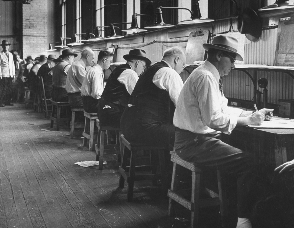 Officials tallying bets made on the 1945 Kentucky Derby. (Photo by Ed Clark//Time Life Pictures/Getty Images)
