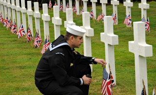 Ship's Serviceman 1st Class Samuel Hernandez-Moreno pays his respects to a fallen service member buried at the Brookwood American Cemetery and Memorial on Memorial Day. There are 468 American casualties from WWI buried at Brookwood, and another 563 missing in action are memorialized by name.  Photo: U.S. Navy by Mass Communication Specialist 2nd Class Jennifer L. Jaqua