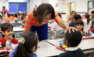 First Lady Michelle Obama visited Parklawn Elementary School in Alexandria, Virginia, Jan. 25, 2012. Mrs. Obama and celebrity cook Rachael Ray were there to serve meals that met the United States Department of Agriculture's new nutrition standards for school lunches.  Official White House Photo by Chuck Kennedy