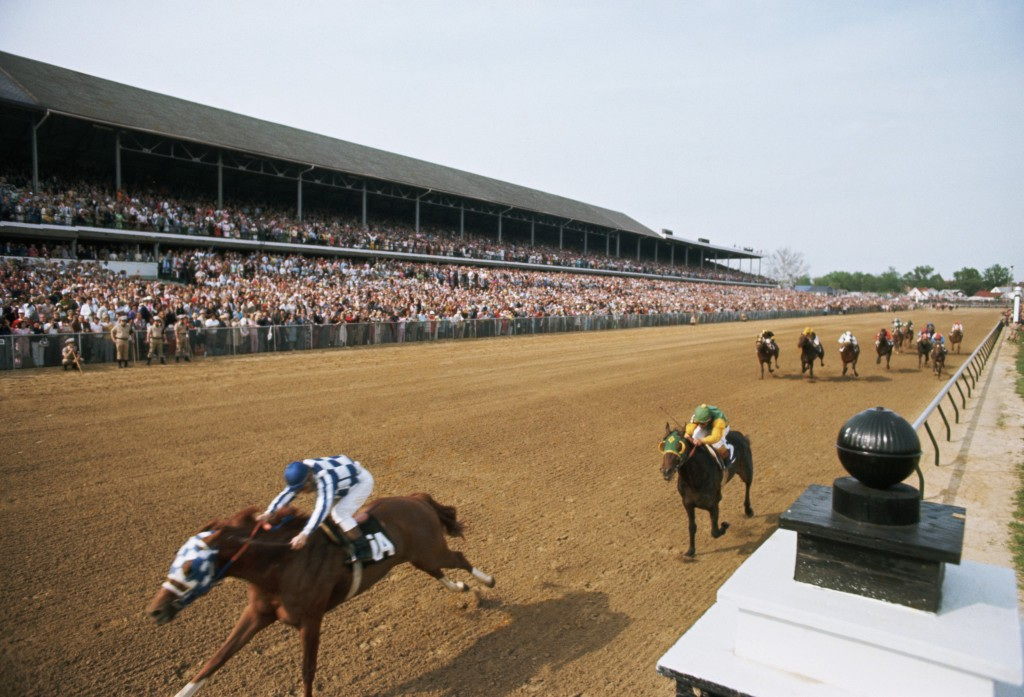 Ron Turcotte in action aboard Secretariat during the 1973 Kentucky Derby.  Secretariat won the Derby and set a speed record that stands to this day. Secretariat would go on to become the ninth horse to win the Triple Crown and the first  in 25 years. Photo by Jerry Cooke/Sports Illustrated/Getty Images