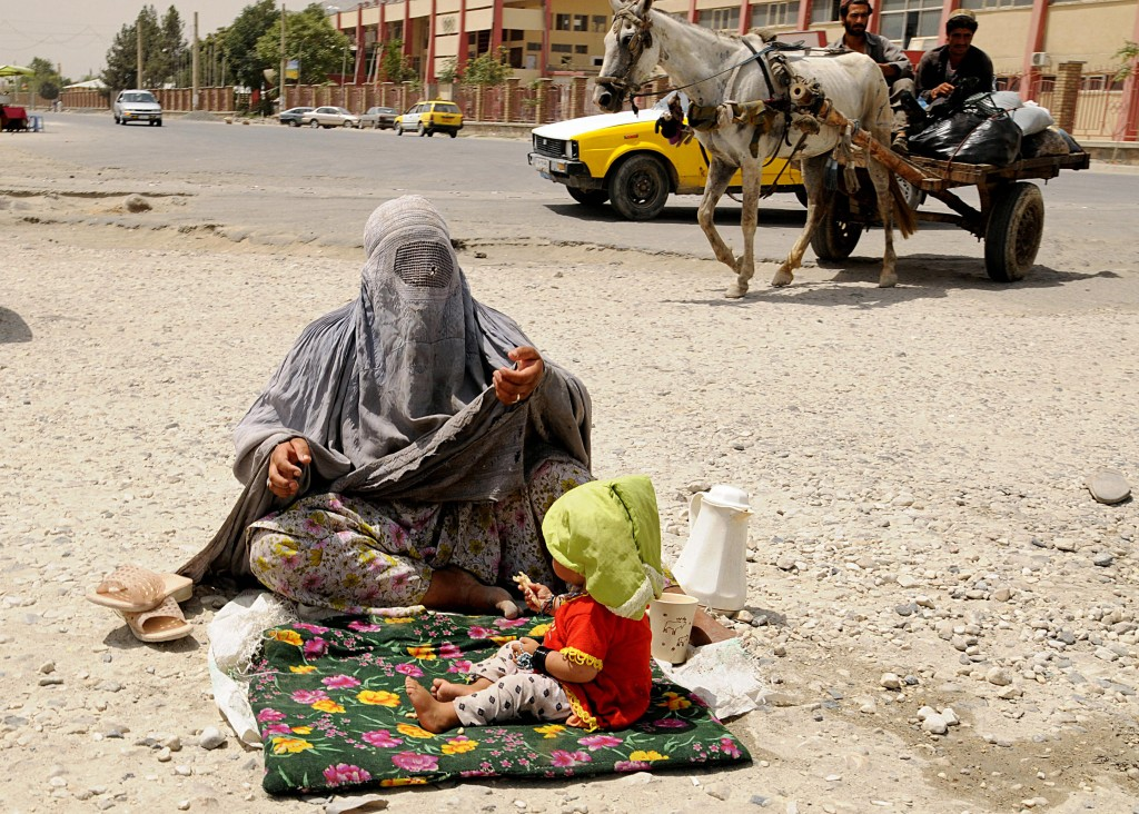 An Afghan woman sits with her child in Kabul on Aug. 17, 2008. Photo by Shah Marai/AFP/Getty Images
