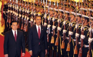 Visiting U.S. President Barack Obama walks beside Chinese President Hu Jintao (left) during the honor guard welcoming ceremony at the Great Hall of the People in Beijing on Nov. 17, 2009. Photo by Frederic J. Brown/AFP/Getty Images