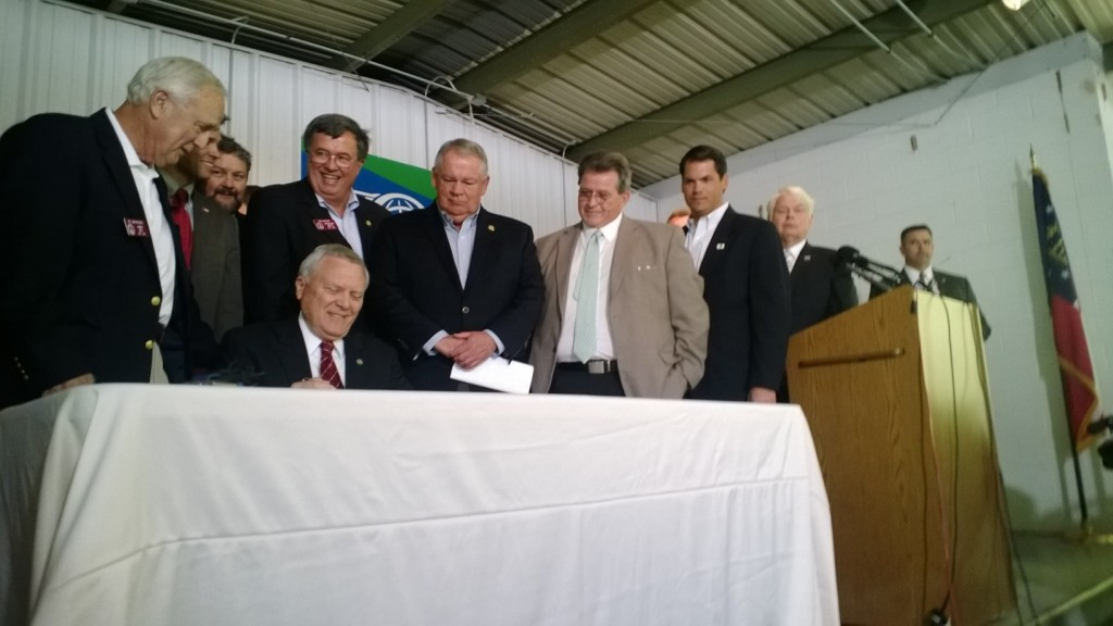 Gov. Nathan Deal signs the Safe Carry Protection Act on April 23, during a during a ceremony in Ellijay, Georgia.  Photo by Jeanne Bonner, GPB