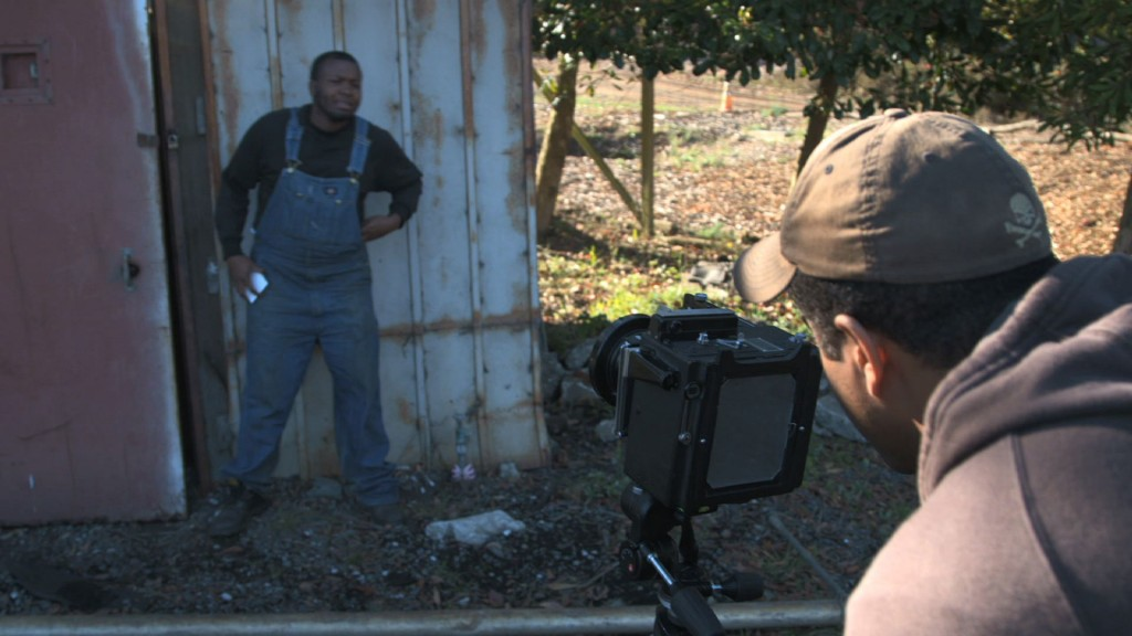Ed Drew taking a tintype photo at The Garden Project in San Bruno, Calif.