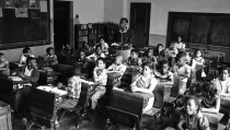 View of nine-year-old African-American student Linda Brown (first desk in second row from right) sits with her classmates at the racially segregated Monroe Elementary School, Topeka, Kansas, 1953. When her enrollment at a 'whites-only' school was blocked, her family initiated the landmark Civil Rights lawsuit 'Brown V. Board of Education,' that led to the beginning of integration in the US education system. (Photo by Carl Iwasaki/Time & Life Pictures/Getty Images)
