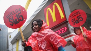 Fast food workers and activists demonstrate outside McDonald's downtown flagship restaurant on May 15 in Chicago. Photo by Scott Olson/Getty Images.