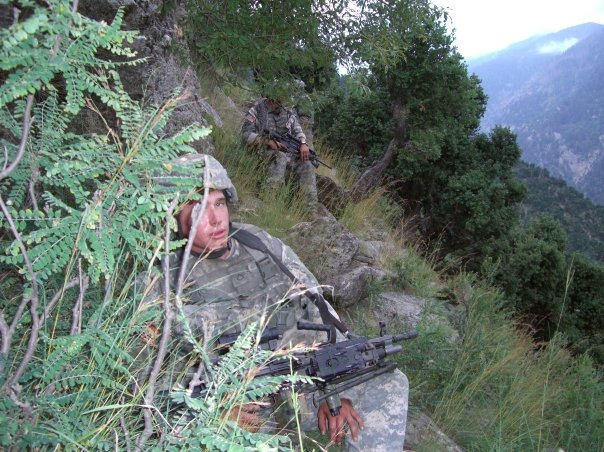 Kyle White on a routine patrol nearby the Aranas village in Afghanistan, in summer of 2007. Photo courtesy of U.S. Army