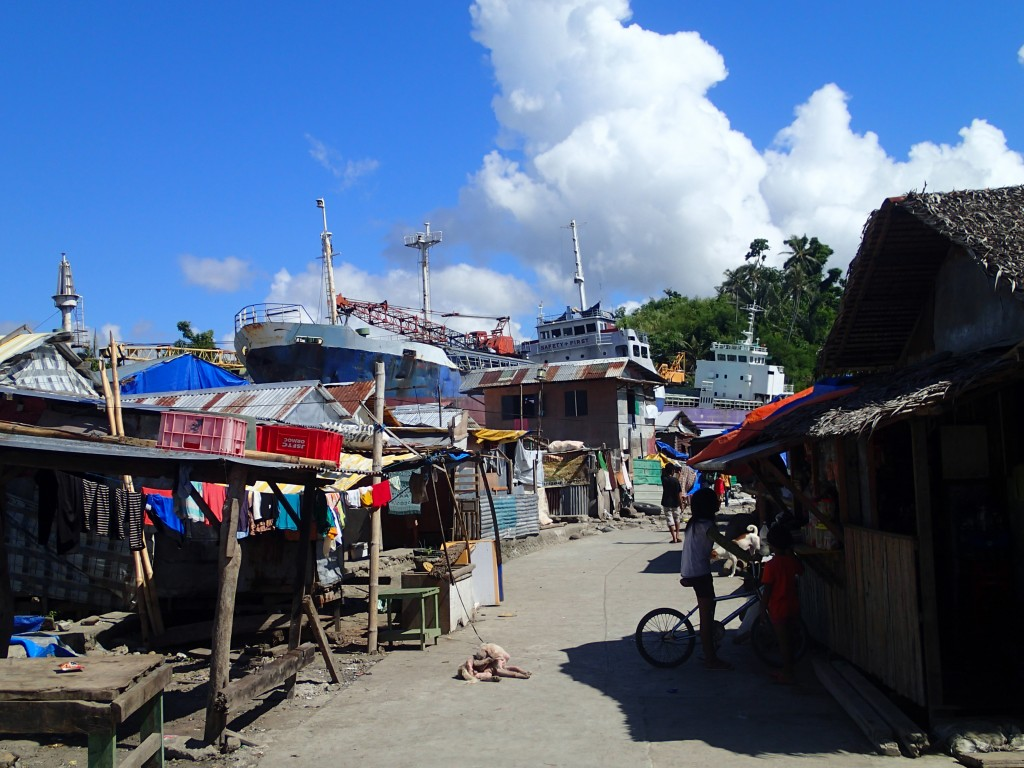 residents of Tacloban have built temporary shelters around a beached ship. These shelters are perilously close to the sea.. a problem that local officials are concerned about.
