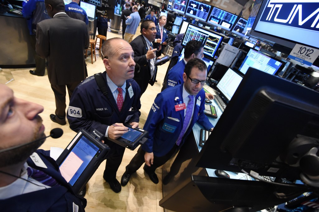 Thomas Piketty isn't too concerned about a bubble on Wall Street right now. Above, traders work on the floor of the New York Stock Exchange just before the opening bell May 13. Photo by STAN HONDA/AFP/Getty Images.
