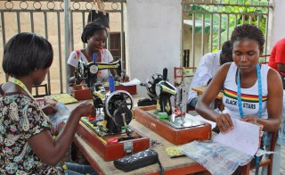 Sewing decorative bags out of recycled materials in Ghana. Photo courtesy of A Ban Against Neglect