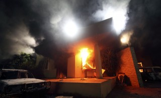 The U.S. Consulate in Benghazi is seen in flames during a protest by an armed group in this file photo taken September 11, 2012. Photo by Esam Al-Fetori/Reuters