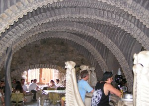 "The ""Giger Bar"" in Gruyeres, Switzerland. H.R. Giger directly supervised the designs. Photo by Wikimedia user Canterbury Tail"