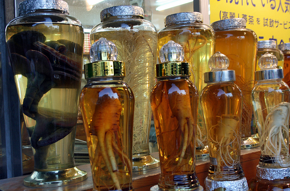 Bottles of ginseng at an outdoor market in Seoul, South Korea. Photo by Larisa Epatko