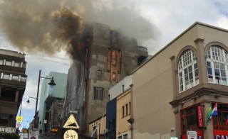 Flames consume the Glasgow School of Art in Scotland. Photo by Flickr user Phyllis Buchanan