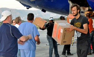 Volunteers offload supplies following the Jan. 12, 2010 earthquake in Haiti.