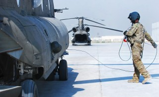 Pfc. Zach Fike, a CH-47 Chinook helicopter crew readies an aircraft at Bagram Air Field, Afghanistan in May 2014.