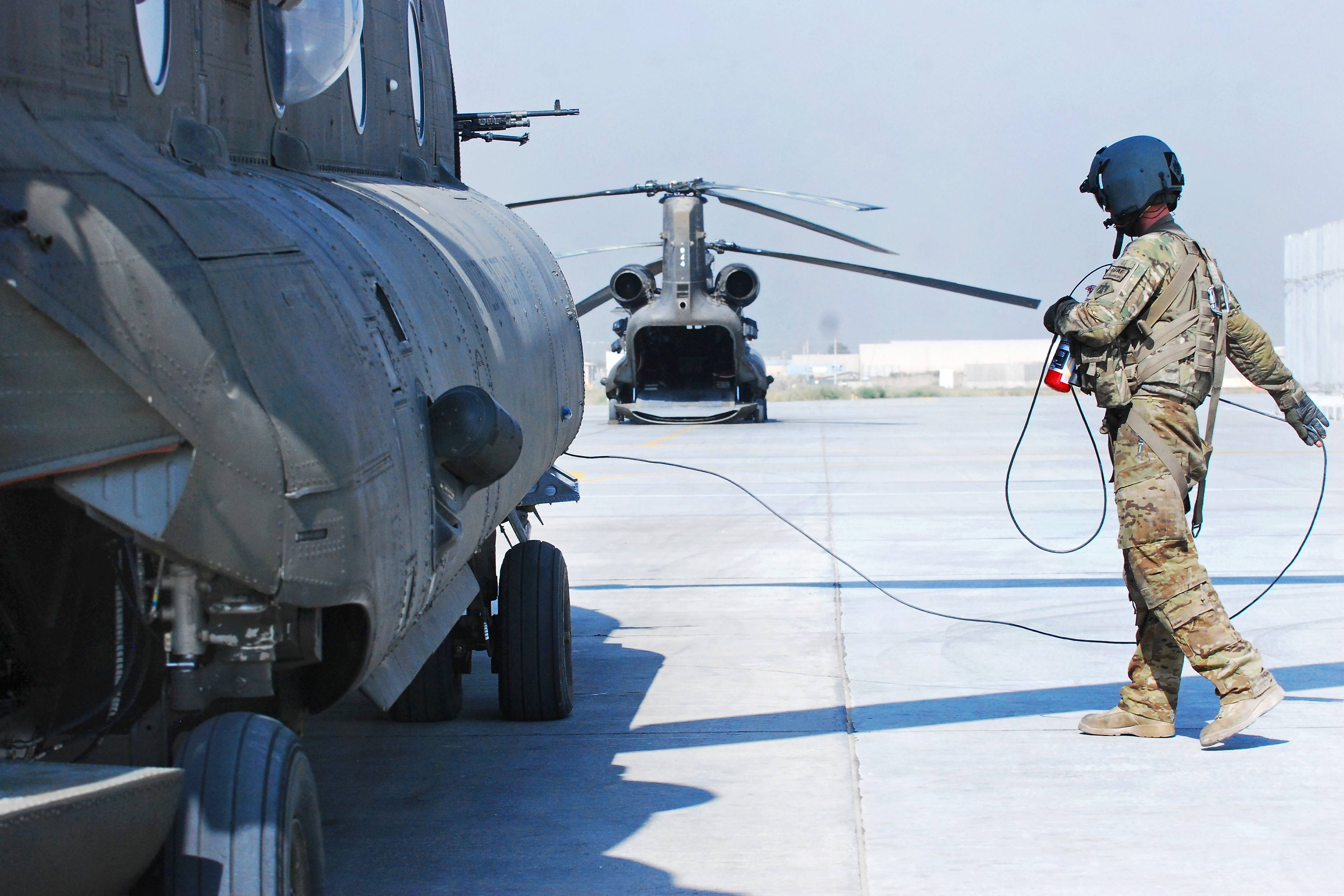 Pfc. Zach Fike, a CH-47 Chinook helicopter crew readies an aircraft at Bagram Air Field, Afghanistan.