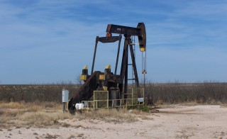Oil Well in Reagan County, Texas. Photo by Flickr user  J. Stephen Conn.