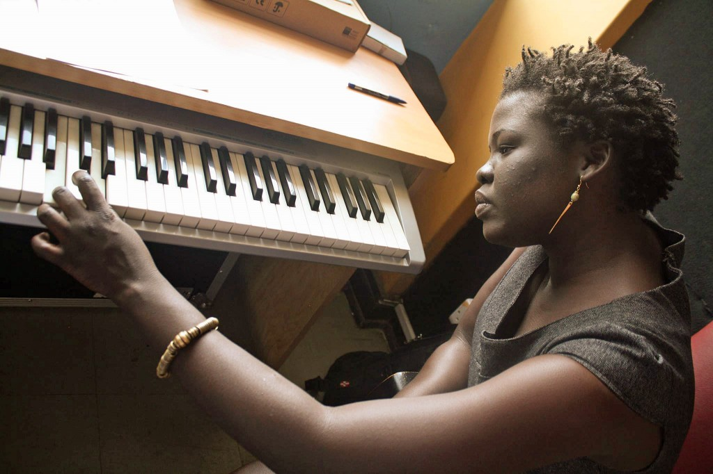 Mer Matthew Obur records the radio drama's opening theme song. Photo courtesy of Sawa Shabab