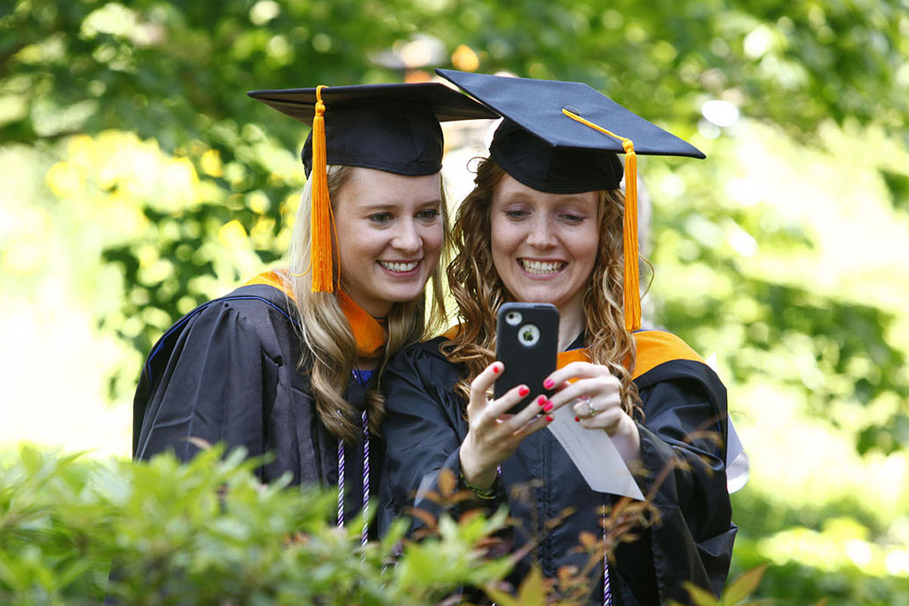 Student snap a 'selfie' at a ceremony at Duke University in 2013. Photo by Flickr user Duke University School of Nursing